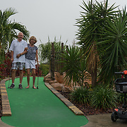 MAY 5, 2017--MARCO ISLAND--FLORIDA<br /> Thomas Johnston, 61, and his wife Pam Johnston, 58, both supported the Republican Party's action to repeal the Affordable Care Act. Mr. Johnston, who manages an 18 hole miniature golf course, watched the vote live on television yesterday. <br /> (Photo by Angel Valentin)