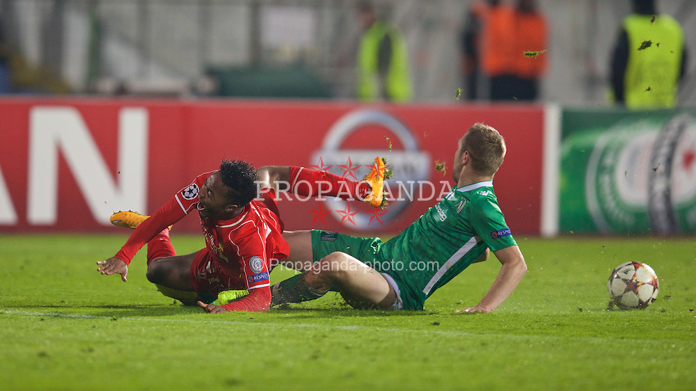 SOFIA, BULGARIA - Wednesday, November 26, 2014: Liverpool's Raheem Sterling is hacked down by PFC Ludogorets Razgrad's Cosmin Moti during the UEFA Champions League Group B match at the Vasil Levski National Stadium. (Pic by David Rawcliffe/Propaganda)
