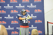 "James Jones of Olive Branch, Miss. tries on a football uniform during ""Meet The Rebels"" at the Manning Center in Oxford, Miss. on Saturday, August 16, 2014. Members of the Ole Miss football, soccer, volleyball, rifle, and women's golf teams, as well as the spirit squads, greeted fans and signed autographs."