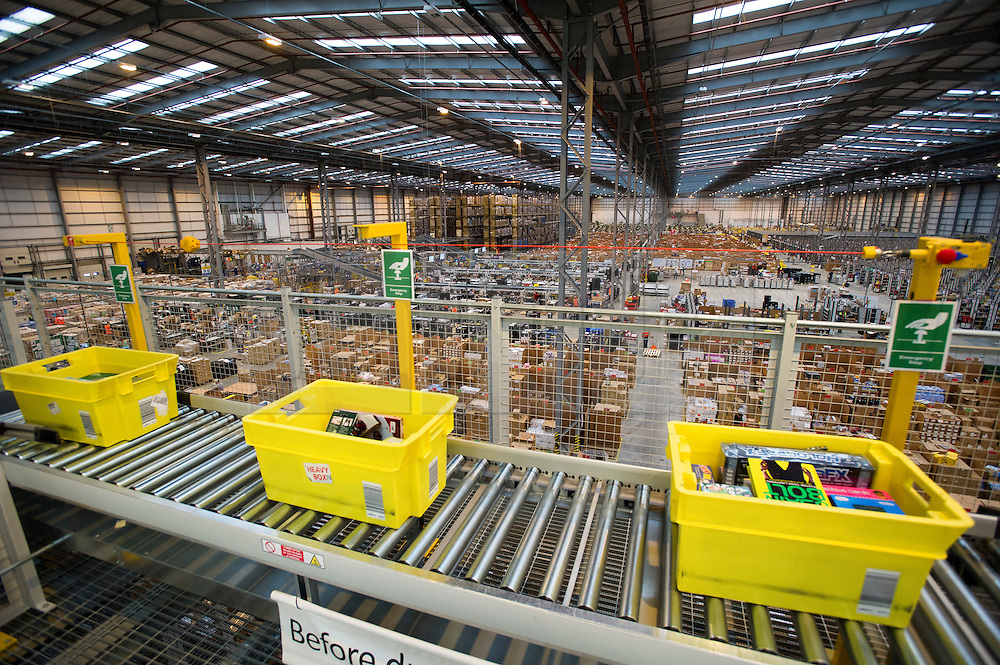 © London News Pictures. 28/11/2013. Peterborough, UK. Staff at the Amazon Peterborough fulfilment centre process orders as they prepare for 'Cyber Monday', busiest online shopping day of the year. On Cyber Monday 2012, Amazon.co.uk saw more than 3.5 million items ordered on the site, at a rate of around 41 items per second. Over 15000 extra staff are drafted in to Amazon nation wide over the festive period to cope with the extra demand with over 1000 extra staff being deployed at the Peterborough site. Photo credit: Ben Cawthra