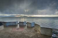 Stormy winter clouds over Bellingham Bay Washington. Seen from Marine Park. Lummi Island in the distance.
