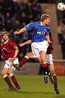 Fotball: Hearts  v  Rangers, Scottish Premier League, Tynecastle, Edinburgh.<br />Tore Andre Flo headas past Thomas Flogel as Steven Pressley looks on.<br />09.02.2002.<br /><br />Foto: Ian Stewart/Digitalsport
