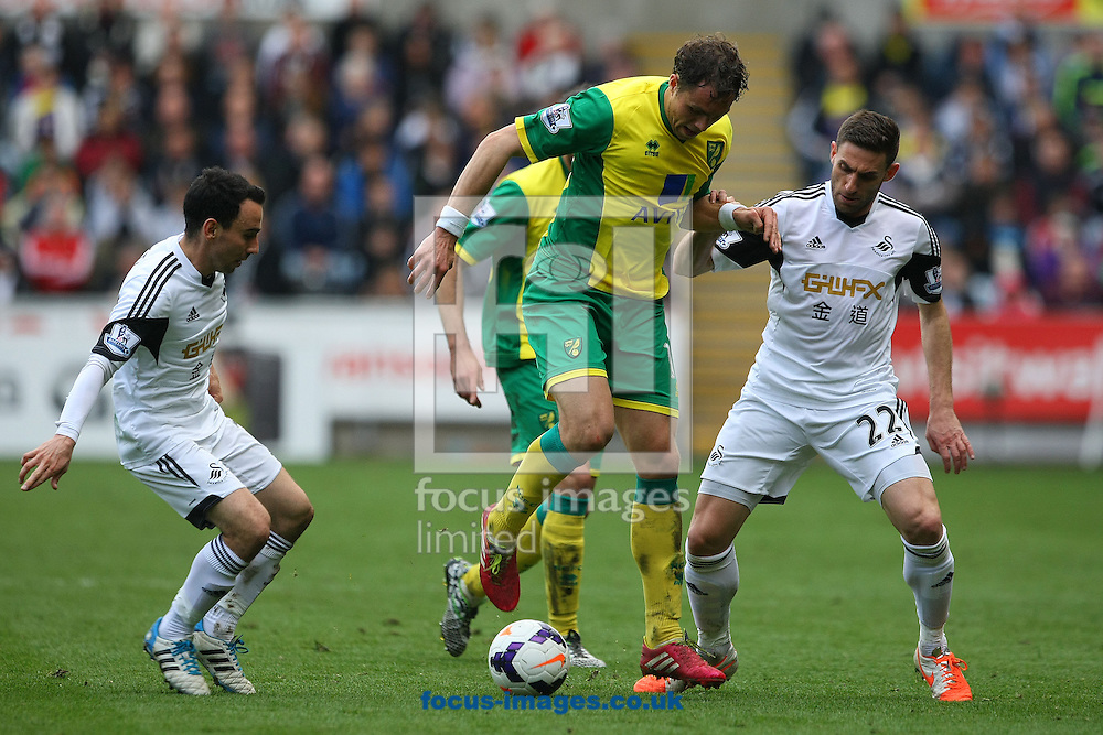 Johan Elmander of Norwich pulls off a back heel during the Barclays Premier League match at the Liberty Stadium, Swansea<br /> Picture by Paul Chesterton/Focus Images Ltd +44 7904 640267<br /> 29/03/2014