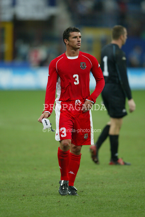MILAN, ITALY - Saturday, September 6, 2003: Wales' captain Gary Speed walks off dejected after losing 4-0 to Italy during the Euro 2004 qualifying match at the San Siro Stadium. (Pic by David Rawcliffe/Propaganda)