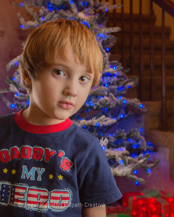 boy and christmas tree portrait