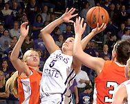 Kansas State guard Shalee Lehning (5) drives and scores against Idaho State during the second half at Bramlage Coliseum in Manhattan, Kansas, March 17, 2006.  K-State defeated the Bengals 88-68 in the first round of the WNIT.