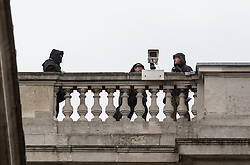 © Licensed to London News Pictures. 22/04/2016. London, UK. Security watch from rooftops as US President Barack Obama visits 10 Downing Street for a joint press conference with British Prime Minister David Cameron. Obama is expected to make his case for the UK to remain inside the European Union, as part of his four day tour to the UK. Photo credit : Tom Nicholson/LNP