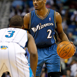 February 1, 2011; New Orleans, LA, USA; Washington Wizards point guard John Wall (2) is guarded by New Orleans Hornets point guard Chris Paul (3) during the fourth quarter at the New Orleans Arena. The Hornets defeated the Wizards 97-89.  Mandatory Credit: Derick E. Hingle