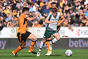 Barnsley midfielder Harvey Barnes (15) on the attack tracked by Wolverhampton Wanderers midfielder Romain Saiss (27) and Wolverhampton Wanderers midfielder Ruben Neves (8) 0-0 during the EFL Sky Bet Championship match between Wolverhampton Wanderers and Barnsley at Molineux, Wolverhampton, England on 23 September 2017. Photo by Alan Franklin.