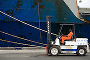 Worker sitting on a tractor at the sea port in Lome, Togo on Friday October 3, 2008.