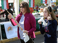 BRISTOL, PA -  SEPTEMBER 14:  Mary Beth O'Flynn (left) of Croydon, Pennsylvania and her niece Sara Pio, 11 of Saylorsburg, Pennsylvania enjoy funnel cake on a stick at the Italian Festival September 14, 2013 in Bristol, Pennsylvania. (Photo by William Thomas Cain/Cain Images)