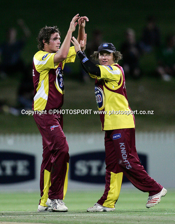 Knights team mates Tim Southee and James Marshall celebrate winning the State Twenty20 cricket match between the Northern Knights and Central Stags at Seddon Park, Hamilton, on Saturday 13 January 2007. The Knights won the match by 2 runs. Photo: Renee McKay/PHOTOSPORT<br />