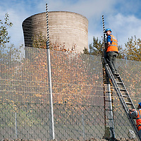 Didcot Oxfordshire October 26  Security reapirs part of the fence after Environmental protestors from Climate Action  broke into Didcot Power Station and climbed the main tower...***Agreed Fee's Apply To All Image Use***.Marco Secchi /Xianpix. tel +44 (0) 771 7298571. e-mail ms@msecchi.com .www.marcosecchi.com