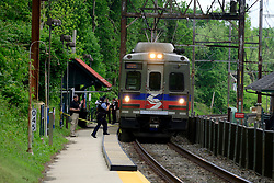 SEPTA service on the Chestnut Hill West line is temporary halted as Police investigates after a conductor suffered a gunshot wound to the hip, in the Mt Airy neighborhood of Philadelphia, PA, on May 10, 2019. Septa Police Chief Thomas J. Nestel says the victim was transported to a nearby hospital were he is listed in stable condition while the gunman remains at large.