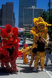 Stock photo of dragon costumes in the Chinese New Year parade in downtown Houston Texas