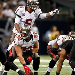 December 16, 2012; New Orleans, LA, USA; Tampa Bay Buccaneers quarterback Josh Freeman (5) against the New Orleans Saints during the first quarter of a game at the Mercedes-Benz Superdome. The Saints defeated the Buccaneers 41-0. Mandatory Credit: Derick E. Hingle-USA TODAY Sports