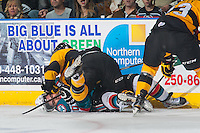 KELOWNA, CANADA - MAY 13: Nick Merkley #10 of Kelowna Rockets is checked to the ice by a player from the Brandon Wheat Kings on May 13, 2015 during game 4 of the WHL final series at Prospera Place in Kelowna, British Columbia, Canada.  (Photo by Marissa Baecker/Shoot the Breeze)  *** Local Caption *** Nick Merkley;