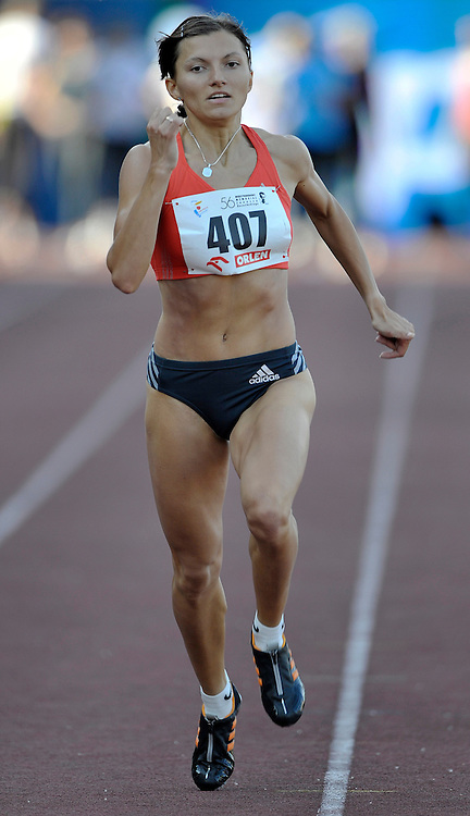 YULIA OLISHEVSKA (UKRAINE) COMPETES IN WOMEN'S 100 METERS RACE DURING 56TH ATHLETIC MEMORIAL OF JANUSZ KUSOCINSKI 2010 IN WARSAW, POLAND...POLAND , WARSAW , JUNE 08, 2010..( PHOTO BY ADAM NURKIEWICZ / MEDIASPORT )
