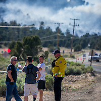 Emergency personnel patrol the Baldwin Lake neighborhood during a mandatory evacuation as the winds shift and the Holcomb Fire burns in the nearby San Bernardino National Forest near Big Bear, Tuesday, June 20, 2017. (EricReed/For The Sun/SCNG)
