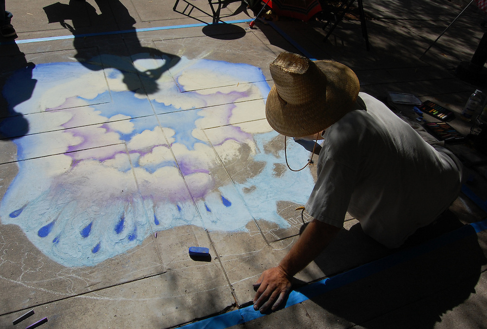 Chalk artist at Livin' La Vida Verde environmental festival in Tucson, Arizona. Event photography by Martha Retallick.