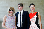 """Anna Wintour, Andrew Bolton and Wendi Murdoch pose Inside the """"China: Through the Looking Glass"""" exhibit at the The Costume Institute in The Metropolitan Museum of Art New York on May 04, 2015."""