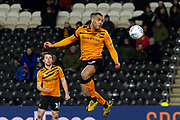 Josh Magennis of Hull City heads the ball during the EFL Sky Bet Championship match between Hull City and Huddersfield Town at the KCOM Stadium, Kingston upon Hull, England on 28 January 2020.