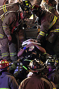 Firefighters work to free trapped colleague Robert Arranaga after a fire ladder truck rolled over at Loop 410 and Culebra Road in San Antonio on Sunday, Nov. 14, 2010. Arranaga was hospitalized with a broken neck and remained on medical leave after the accident.