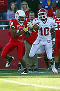15 October 2011: Tyrone Walker can't control the ball and after bobbling give it up to Marquis Butler during an NCAA football game between the University of South Dakota Coyotes and the Illinois State Redbirds (ISU) at Hancock Stadium in Normal Illinois.