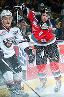 KELOWNA, CANADA - NOVEMBER 11: Gordie Ballhorn #4 of Kelowna Rockets checks Elliott Peterson #23 of Vancouver Giants on November 11, 2015 at Prospera Place in Kelowna, British Columbia, Canada.  (Photo by Marissa Baecker/ShoottheBreeze)  *** Local Caption *** Gordie Ballhorn; Elliott Peterson;
