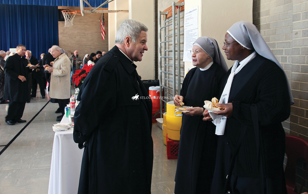 Archbishop Carlson visited with Little Sisters of the Poor Bernard Hopkins and Mary Paschal last December at a reception in Boland Hall following a Mass of Thanksgiving for the Canonization of St Jeanne Jugan, foundress of the order.  The Mass took place at the Cathdedral Basilica of St Louis.