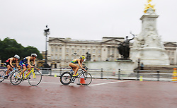 © Licensed to London News Pictures. 14/09/2013. London, UK. Women's final with Aus  Moffet leading the women in the cycle with Buckingham palace in the background. The elite men's race during the World Triathlon Grand Final in Hyde Park, London, Sunday, September 15, 2013.. Photo credit : Alexander Beer/LNP