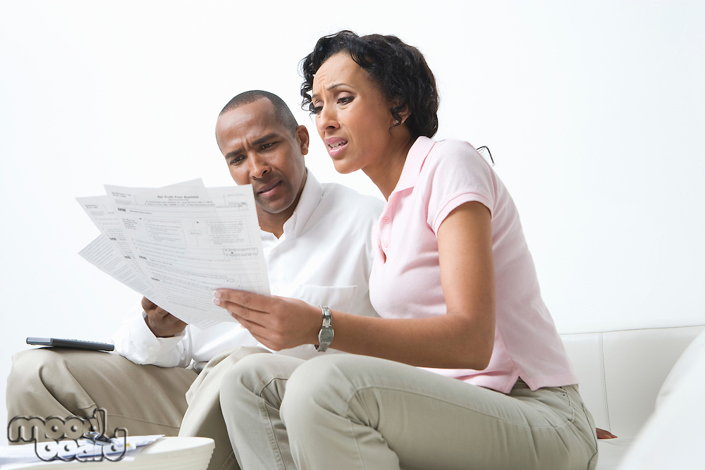 Couple Talking About Bills
