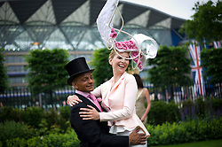 © London News Pictures. 18/06/2013. Ascot, UK.  Anneka Tanaka-Svenska (right) wearing an elaborate hat on day one of Royal Ascot at Ascot racecourse in Berkshire, on June 18, 2013.  The 5 day showcase event,  which is one of the highlights of the racing calendar, has been held at the famous Berkshire course since 1711 and tradition is a hallmark of the meeting. Top hats and tails remain compulsory in parts of the course. Photo credit should read: Ben Cawthra/LNP
