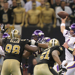Jan 24, 2010; New Orleans, LA, USA; Minnesota Vikings quarterback Brett Favre (4) throws as New Orleans Saints defensive tackle Sedrick Ellis (98) and linebacker Jonathan Vilma (51) provide pressure during a 31-28 overtime victory by the New Orleans Saints over the Minnesota Vikings in the 2010 NFC Championship game at the Louisiana Superdome. Mandatory Credit: Derick E. Hingle-US PRESSWIRE