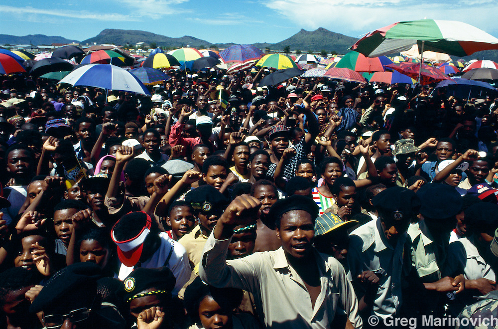 ANC supporters cheer Nelson Mandela during a Campaign Rally ahead of South Africa's first non racial elections. 1994.