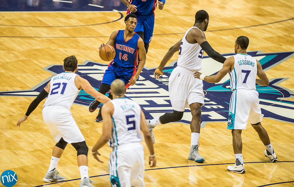 Former Central Cabarrus standout Ish Smith (14) of the Detroit Pistons, during a game against the Charlotte Hornets Wednesday night at the Spectrum Center in Charlotte.