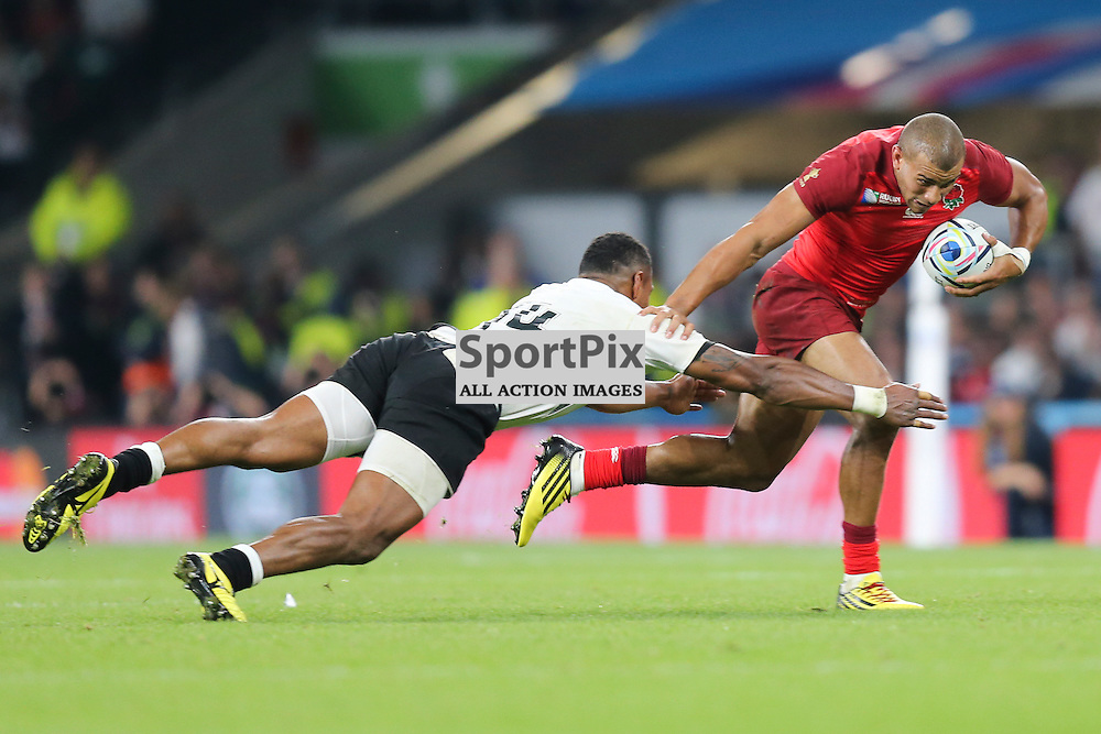 TWICKENHAM, ENGLAND - SEPTEMBER 18: England's outside centre Jonathan Joseph (13) hands off Waisea Nayacalevu of Fiji during the opening game of the Rugby World Cup between England and Fiji at Twickenham on September 18, 2015 in London, England. (Credit: SAM TODD | SportPix.org.uk)