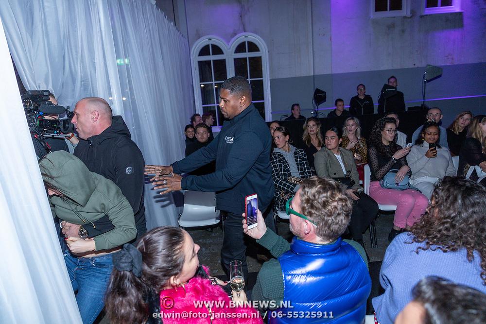 NLD/Amsterdam/20200109 - Fashionshow Famke Louise, gespeelde  verf aanvalf door een dierenactiste