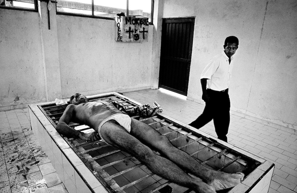 The corpse of a man killed by two gunshots to the head lies in the morgue in Puerto Asis. Power struggles between the leftwing FARC rebels and rightwing AUC paramilitaries who both seek to control the hugely profitable and  illegal cocaine trade in the region leave many dead each week, gunshot wounds being the main cause of death.<br />