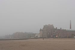 Pictured: A near desetred beach at Portobello, near Edinburgh, with the early morning mist rolling in from the River Forth.  Locals and visitors are hoping for the mist to burn off like yesterday to allow some fun and games in the sun.<br /> <br /> <br /> &copy; Jon Davey/ EEm