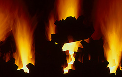 Stock photo of fires heating industrial machinery parts