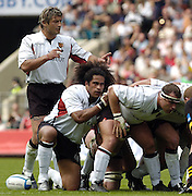 Twickenham, GREAT BRITAIN, 2004 Heineken Cup Final. Toulouse No 8 Christian Labit [left] directs the scrum before the put in Finau Maka [kneeling] and prop Jean-Baptiste Poux. , during the  London London Wasps v Toulouse, final at Twickenham on  23/05/2004  [Credit Peter Spurrier/Intersport Images]   [Mandatory Credit, Peter Spurier/ Intersport Images].