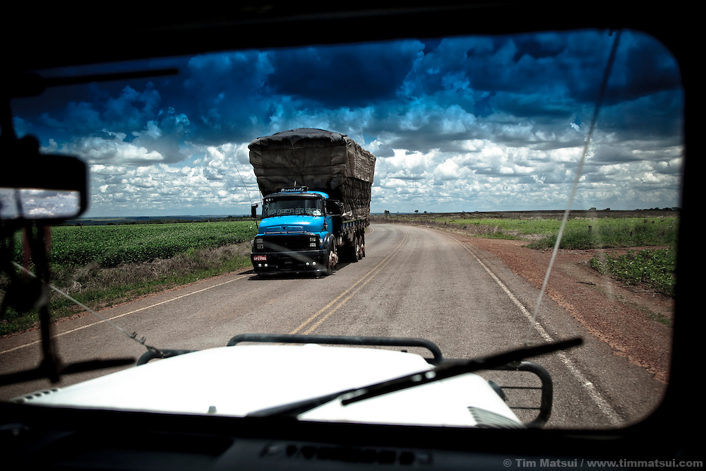A heavy cargo truck passes on an otherwise empty road in the farming country near Brasilia, Brazil.