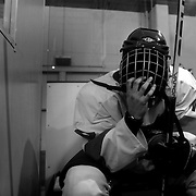 Two Minute Penalty… Firat Erdem, Turkey..Expressions in the penalty box of players serving a two minute penalty during the 2012 IIHF Ice Hockey World Championships Division 3 contested by New Zealand, Iceland, Bulgaria, Turkey and China at Dunedin Ice Stadium. Dunedin, Otago, New Zealand. January 2012. Photo Tim Clayton