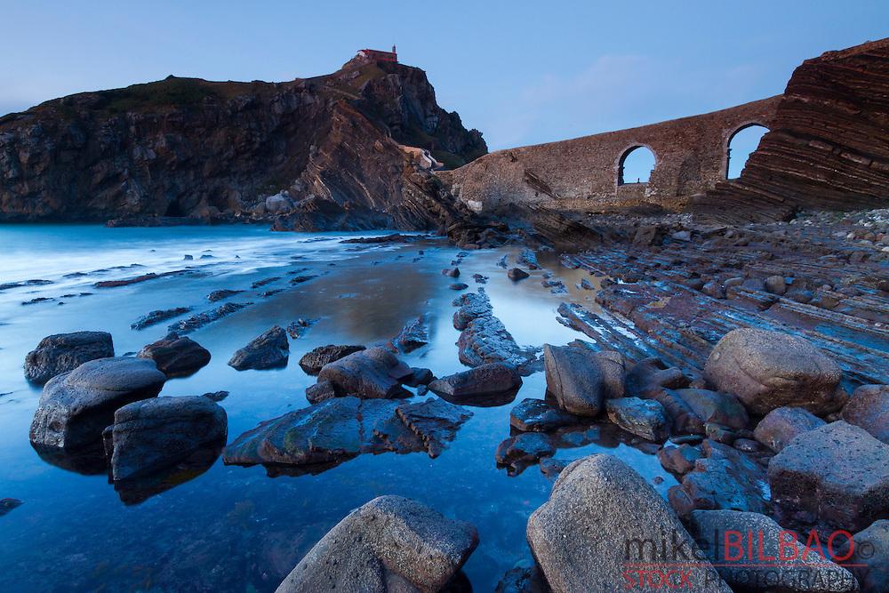 Coast at sunset. San Juan de Gaztelugatxe. Bermeo, Biscay, Basque Country, Spain.