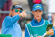 Miguel Angel Jimenez discusses club selection with his caddy prior to teeing off for round 3 of the Seniors Open at St Andrews, West Sands, Scotland on 28 July 2018. Picture by Malcolm Mackenzie.