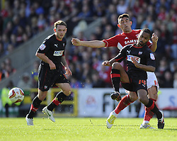 Brentford's Shaleum Logan battles for the ball with Swindon Town's Gary Roberts - Photo mandatory by-line: Joe Meredith/JMP - Tel: Mobile: 07966 386802 04/05/2013 - SPORT - FOOTBALL - County Ground - Swindon - Swindon Town v Brentford - Npower League one Play Off