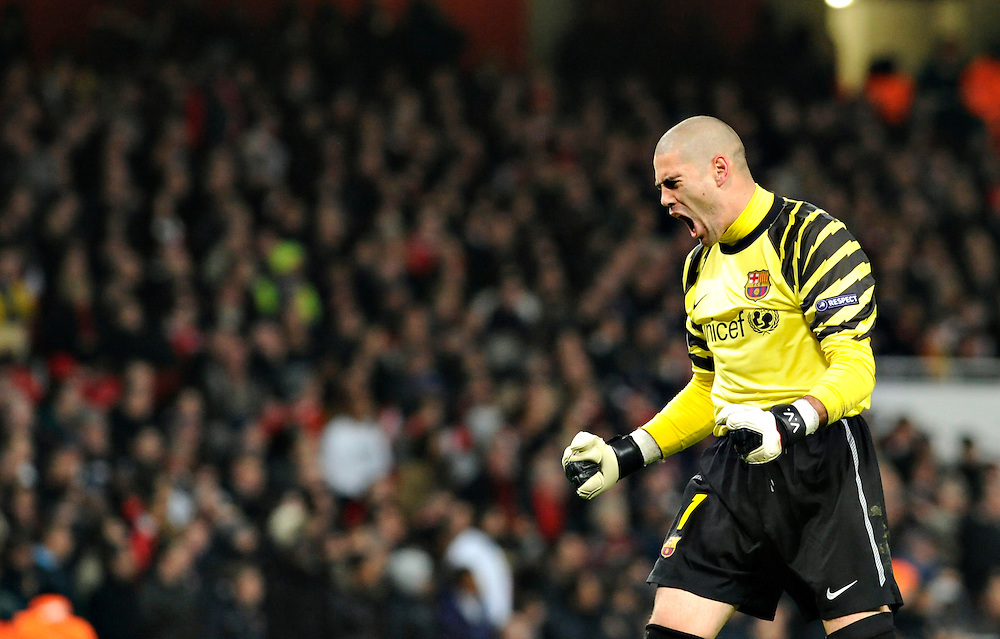Barcelona goalkeeper Victor Valdes , reacts during a Champions League, round of 16 first leg soccer match between Arsenal and Barcelona at the Emirates stadium in London, UK, Wednesday, Feb. 16, 2011.