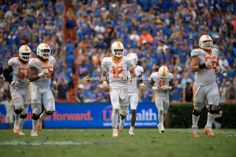 Tennessee quarterback Quinten Dormady (12) jogs on the field with teammates during the second half of an NCAA college football game against Florida Saturday, Sept. 16, 2017, in Gainesville, Fla. Florida won 26-20. (Photo by Phelan M. Ebenhack)