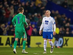 BIRKENHEAD, ENGLAND - Friday, January 4, 2019: Tranmere Rovers' Steve McNulty (R) and goalkeeper Scott Davies during the FA Cup 3rd Round match between Tranmere Rovers FC and Tottenham Hotspur FC at Prenton Park. (Pic by David Rawcliffe/Propaganda)